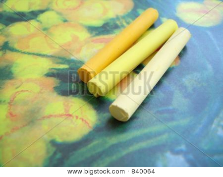 set of yellow crayon on a picture