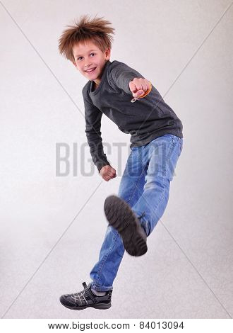 Portrait Of Boy  Jumping And Dancing