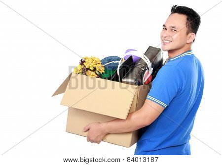 Young Man Carrying Box Full Of Stuff
