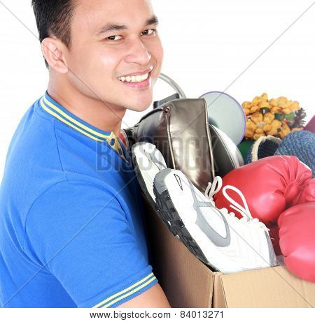 Happy Young Man Carrying Box Full Of Stuff