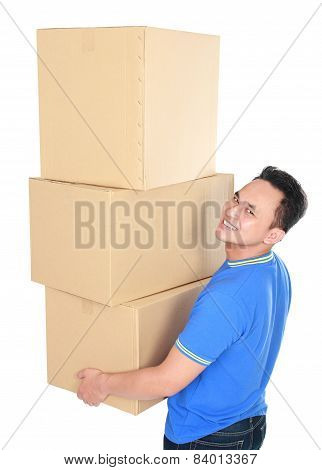 Young Man Carrying Stack Of Cardboxes