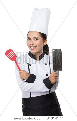 Female Chef In A Traditional Hat And Coat