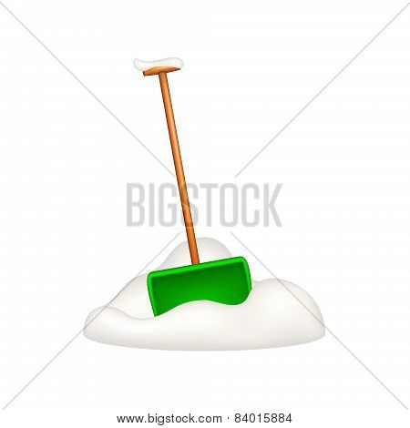 Green snow shovel standing in snow