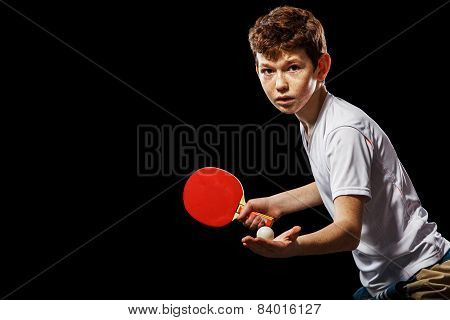 Boy playing table tennis on a black background