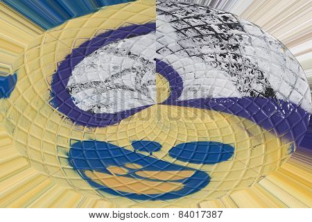 abstract forms of a painted metallic surface with spiral lines