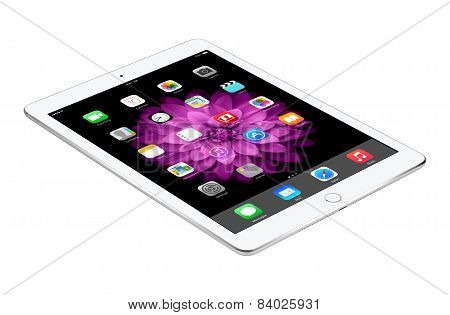 Apple Silver Ipad Air 2 With Ios 8 Lies On The Surface, Designed By Apple Inc.
