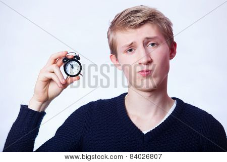 Guy With Little Alarm Clock.