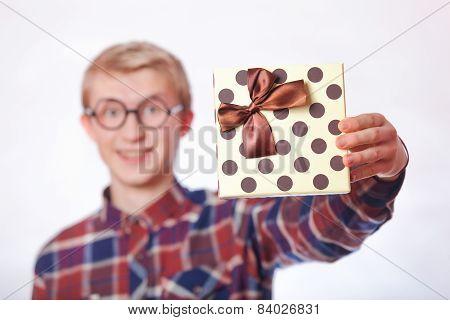 Nerd Teen Guy With Gift.