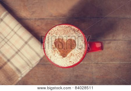 Cup With Coffee And Shape Of The Cacao Heart On It And Scarf