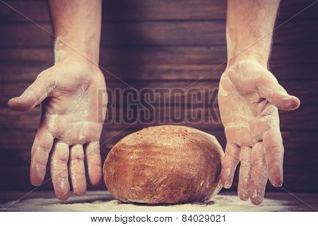 Baker's Hands With A Bread.