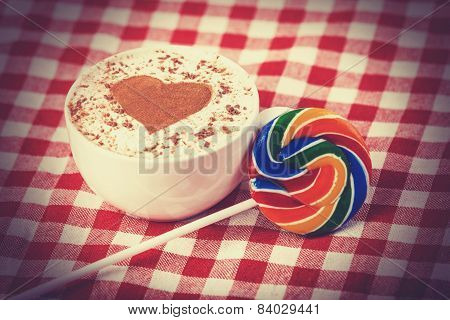Cup Of Coffee With Tartan And Lollipop