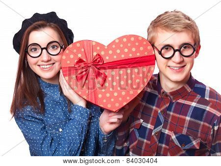 Teen Couple With Heart Shape Gift.