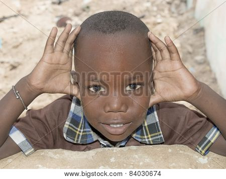 Thiaroye, Senegal, Africa - August 2, 2014: Unidentified boy standing in the street