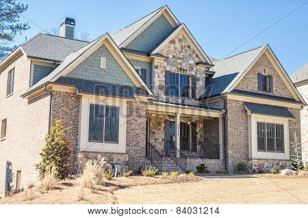 Brown Brick Stone And Slate House