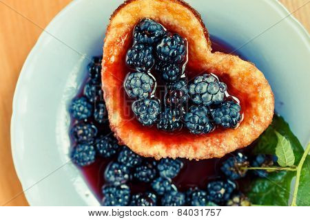heart-shaped omelet with blackberry