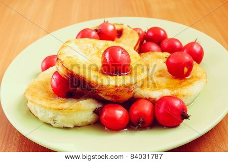 Sweet berry omelet decorated with hawthorn pn green plate