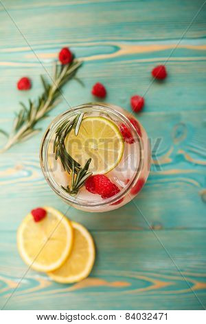 detox water with raspberry, lime, lemon and rosemary