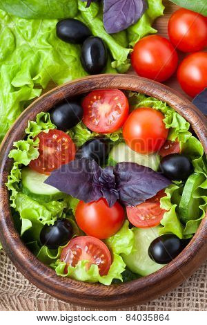 Superfood Vegetarian Salad With Tomato And Olives On Rustic Background Top View