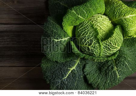 Savoy Cabbage Superfood On Dark Wooden Background