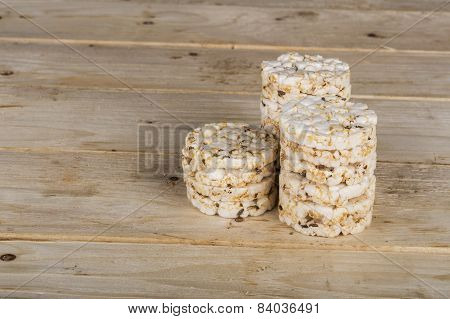 Mini Puffed Rice Cake With Cumin And Salt On Wooden Background