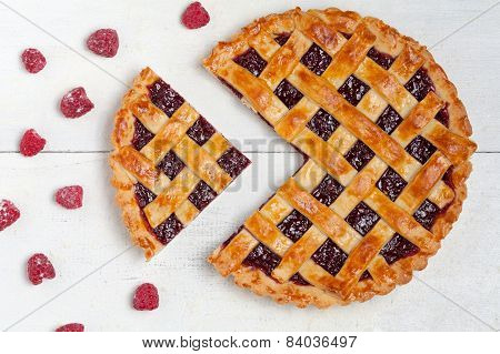 Sliced Raspberry Pie With Fresh Raspberries On White Table