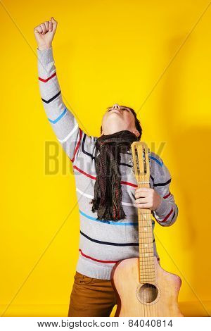 Affective Teenage Boy With Guitar. Music Concept.