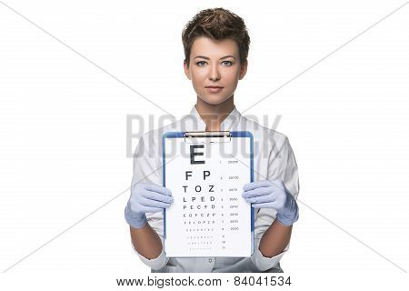 young woman ophthalmologist with eye chart