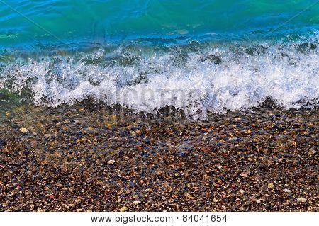 Foamy Wave On Pebble Beach