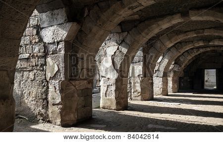 Dark Corridor Interior With Arcs. Ruins Of Ancient Smyrna
