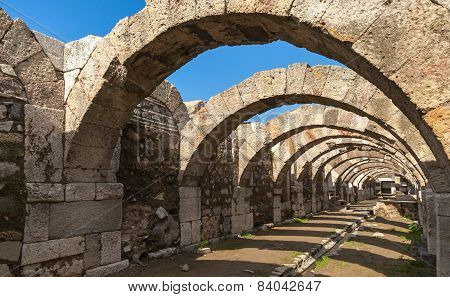 Empty Corridor With Arcs And Blue Sky. Ruins Of Smyrna