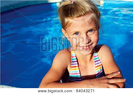 Beautiful Girl In A Bathing Suit, Goggles, Holding On Overboard In A Swimming Pool