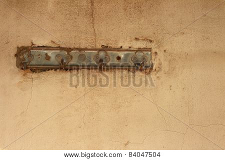 Old Hanger On The Pink Of Wall