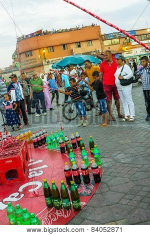 Fishing for bottles in Marrakesh