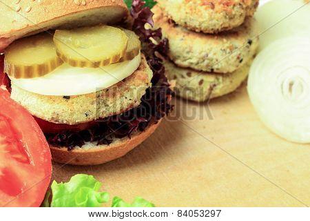 Vegan Sea Burger And Patties Closeup On Wooden Surface