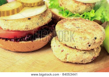 Vegan Sea Burger And Patties Closeup On Wooden Surface