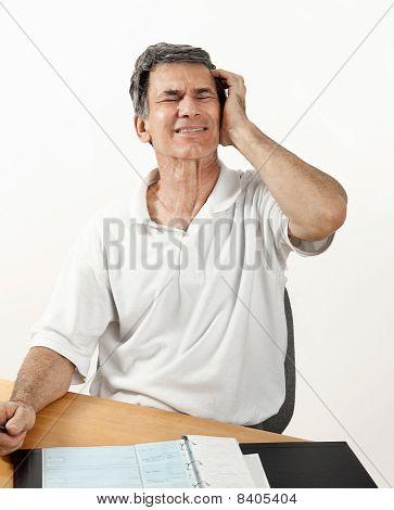 Worried Man Suffering With Headache