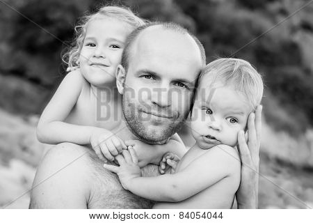 Happy Father And Daughter And Son