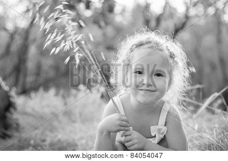 Cute Little Girl Holding A Bouquet