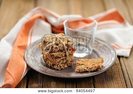 Granola Bars With Empty Glass On Wooden Background