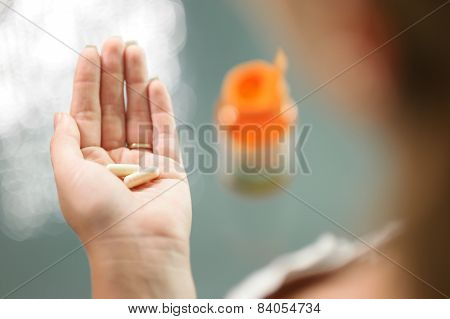 Young Woman Taking Vitamins Ginseng Calcium Pill