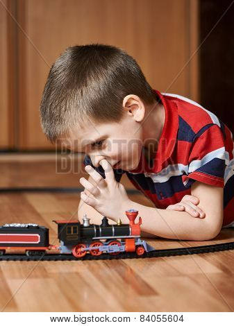 Little Boy Playing With Railway And Pick Your Nose