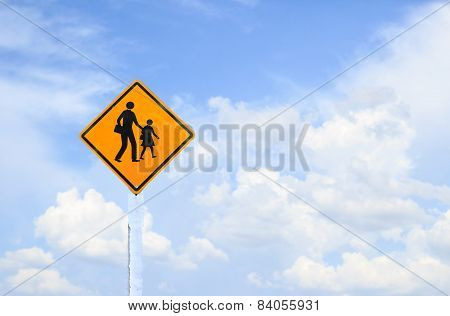 Yellow Traffic Sign With White Clouds And Blue Sky