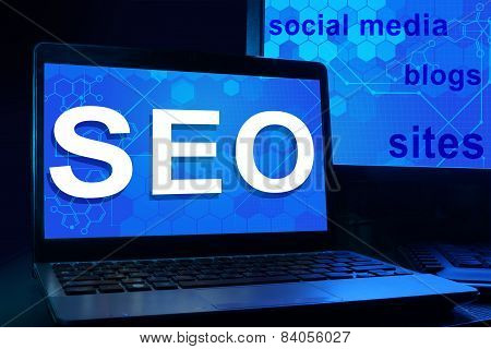 Computer with words SEO (Search Engine Optimization).