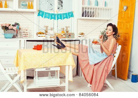 Girl Sitting In The Kitchen.