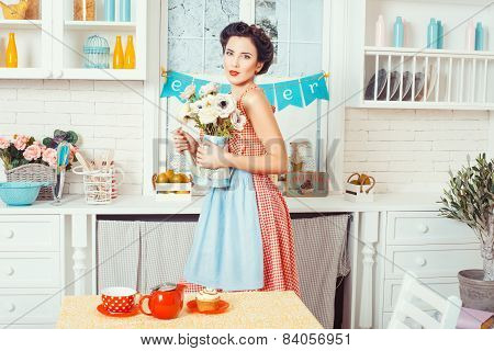The Girl In The Kitchen With Flowers.