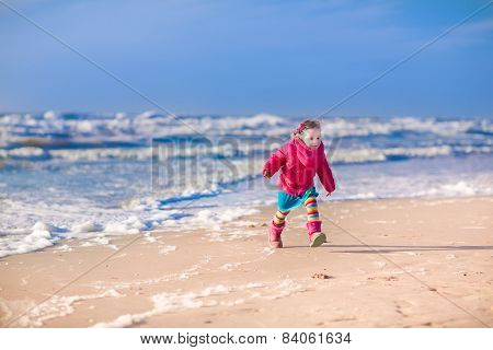 Little Girl At Winter Beach