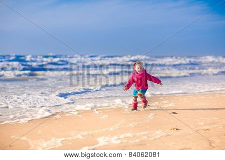 Little Girl At A Beach In Winter