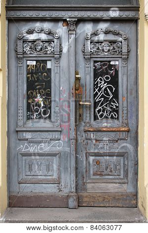 Old Wooden Door In Prague, Written In Graffiti