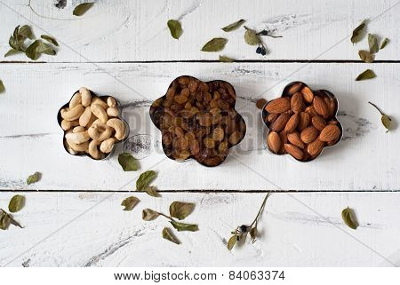 Almonds, Cashews And Raisins In A Cookie Cutters