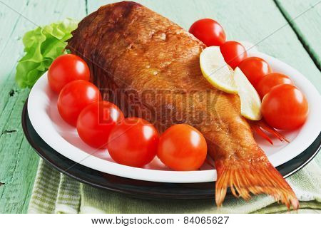 Smoked Sea Bass On Green Wooden Background